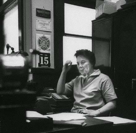 This photograph was taken on May 1, 1961, by Donald Uhrbrock for a LIFE magazine article on Harper Lee. The article appeared in the May 26 issue of LIFE and, according to the caption, the photo shows Lee sitting at a typewriter in her father's law office during a trip back to her home town of Monroeville, Alabama. It was in this office, according to LIFE, that To Kill a Mockingbird was written.