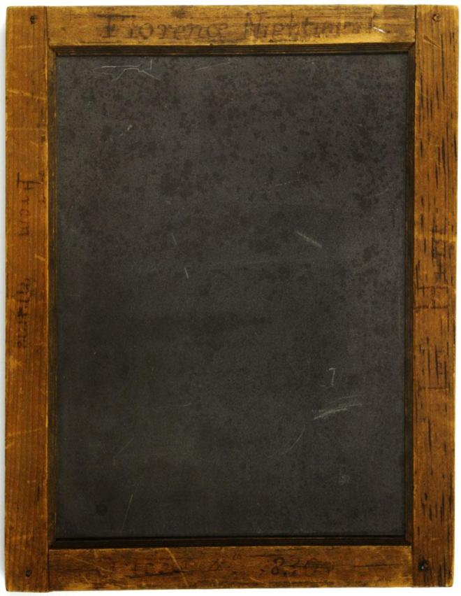 Writing slate in an inscribed, wooden frame. Given to Florence Nightingale by her mother on 11th October, 1830.