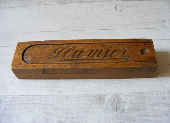 French Vintage wooden pencil box,where is inscribed 'Plumier',with a sliding lid,from the 1940s.